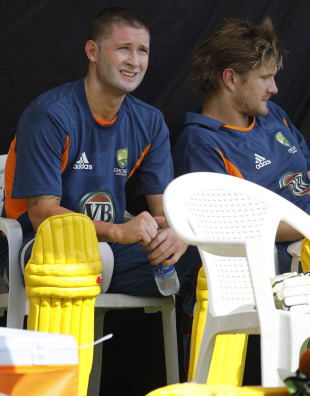 Michael Clarke and Shane Watson await their turn to bat during practice, Ahmedabad, March 22, 2011