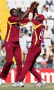 Sulieman Benn and Darren Sammy celebrate, Ireland v West Indies, Group B, World Cup, Mohali, March 11, 2011