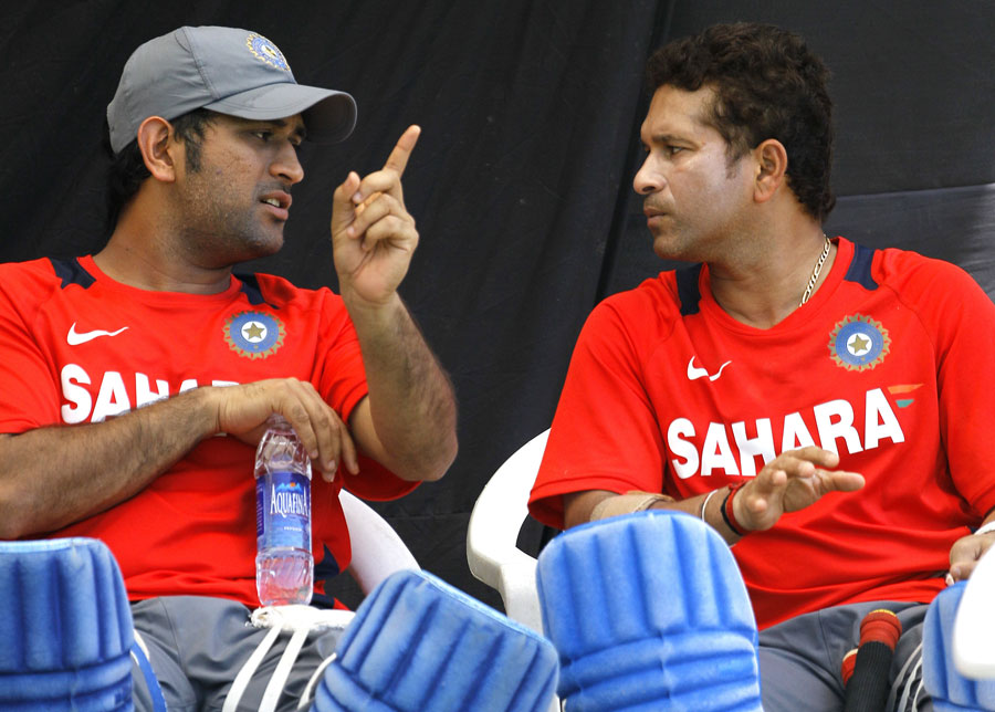 MS Dhoni and Sachin Tendulkar have a chat during India's training session