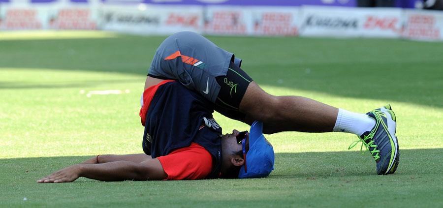 Suresh Raina loosens up during India's training session