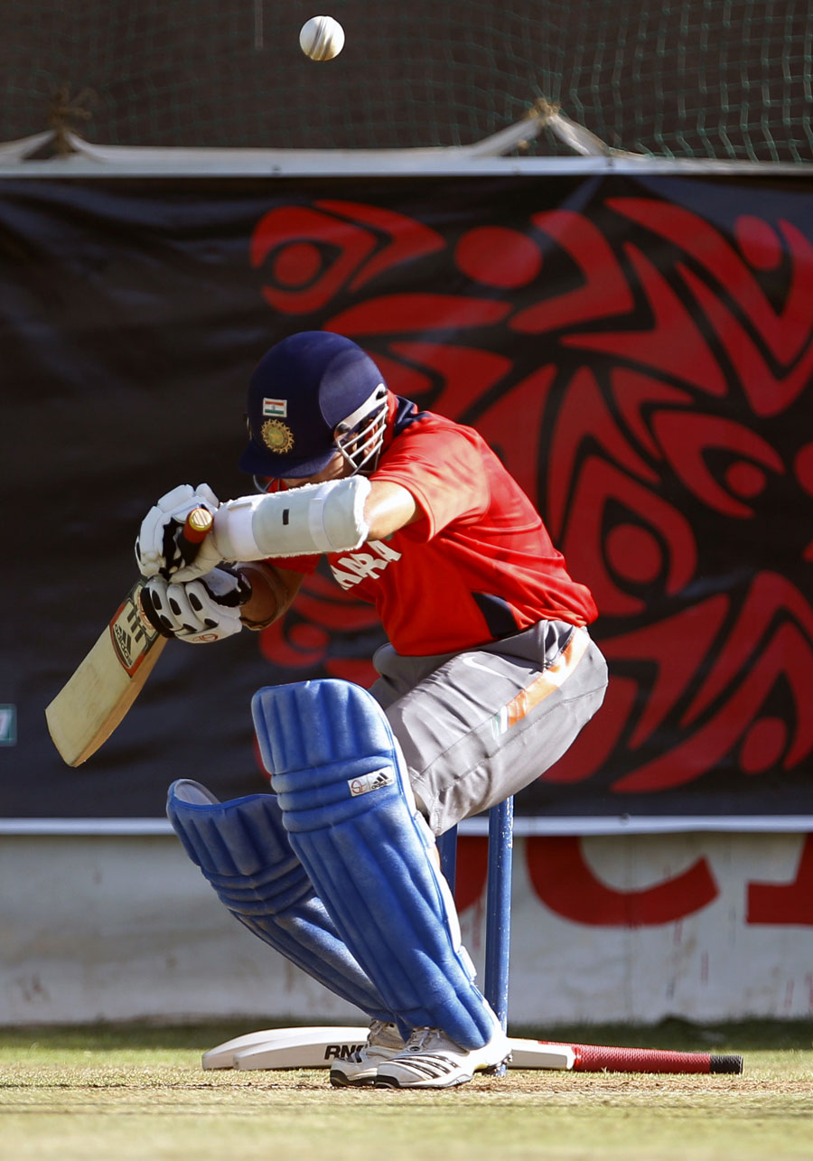 Sachin Tendulkar ducks a bouncer in the nets