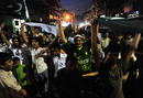 Fans in Islamabad wave flags in the street after Pakistan went through to the World Cup semi-finals, Islamabad, March 23, 2011