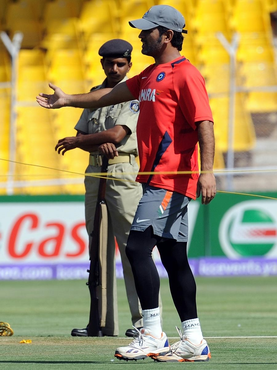 MS Dhoni inspects the pitch