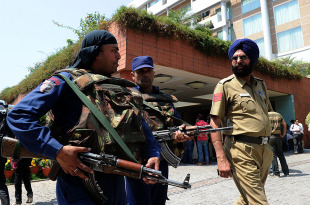 Security personnel stand guard outside the team hotel in Mohali ahead of the semi-final clash between India and Pakistan, Mohali, March 26, 2010
