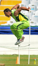 Shoaib Akhtar jumps over a hurdle during a training session , Mohali, World Cup 2011, March 26, 2011