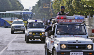 The Pakistan team bus heads to a training session, escorted by security, Mohali, March 27, 2011