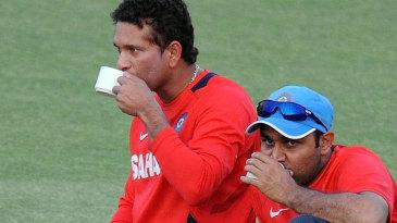 Sachin Tendulkar and Virender Sehwag sip some tea during a break from training