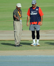 MS Dhoni and curator Daljit Singh inspect the Mohali pitch, Mohali, March 27, 2010