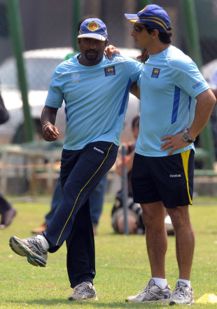 Muttiah Muralitharan does some stretches in training, Colombo, March 28, 2011