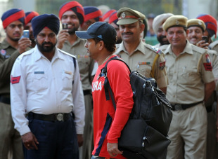 Police officers look on as Sachin Tendulkar leaves the ground, Mohali, March 28, 2011