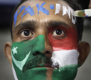 A fan gets his face painted a day ahead of the India-Pakistan match, Guwahati, World Cup, March 29, 2011