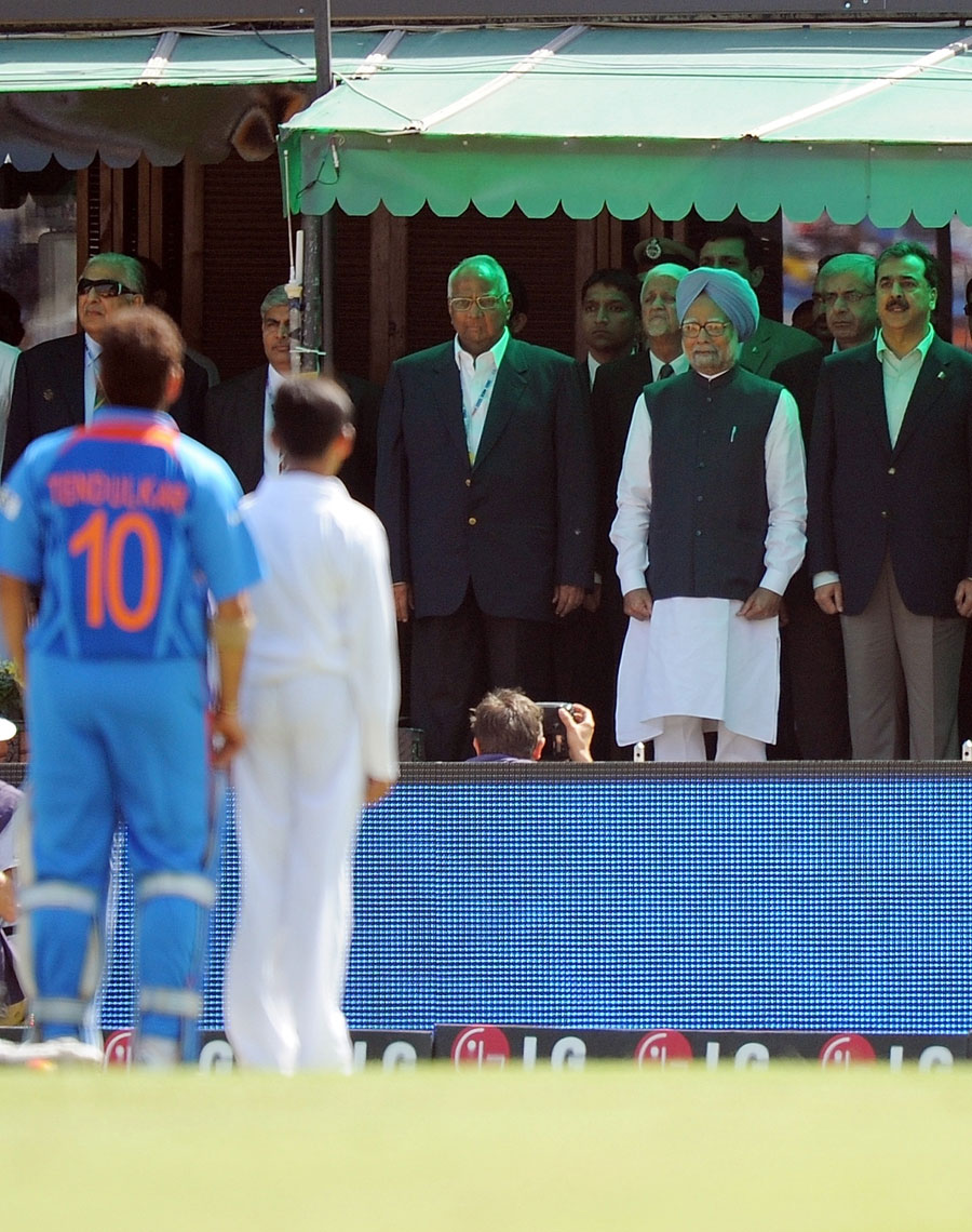 India PM Manmohan Singh and Pakistan PM Yousuf Raza Gilani stand for the national anthems prior to the match