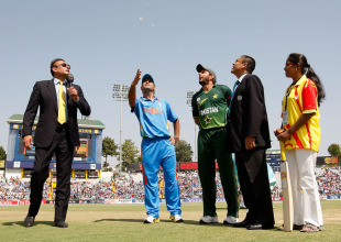 MS Dhoni spins the coin as the semi-final gets underway, India v Pakistan, 2nd semi-final, World Cup 2011, Mohali, March 30, 2011