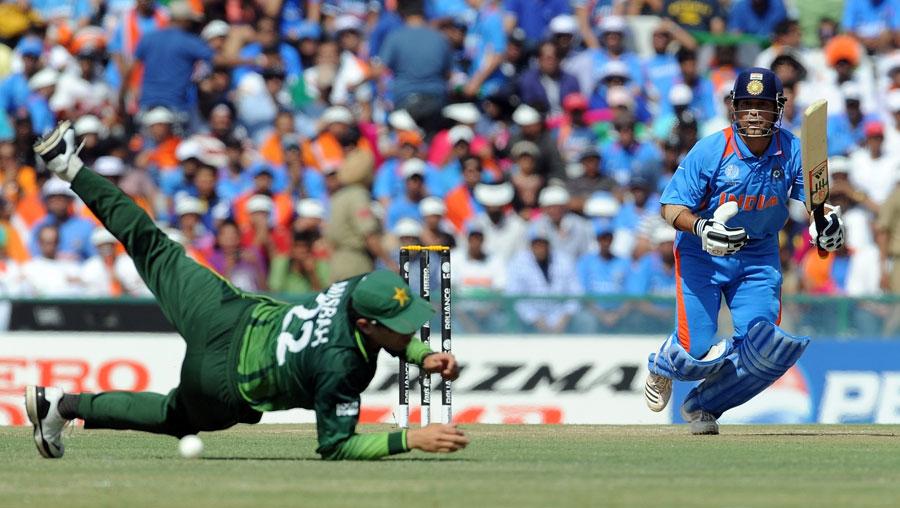 Sachin Tendulkar gets the ball past Misbah-Ul-Haq for a boundary