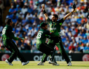 Saeed Ajmal and Kamran Akmal rush to celebrate Sachin Tendulkar's dismissal with Shahid Afridi, World Cup 2011, Mohali, March 30, 2011