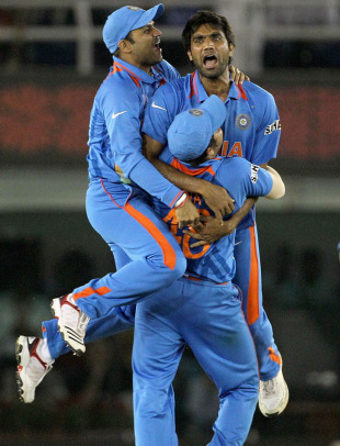Suresh Raina inexplicably holds Munaf Patel and Virender Sehwag aloft after Abdul Razzaq's dismissal, India v Pakistan, 2nd semi-final, World Cup 2011, Mohali, March 30, 2011