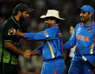 Shahid Afridi congratulates Sachin Tendulkar and Virender Sehwag after the hard-fought game, India v Pakistan, 2nd semi-final, World Cup 2011, Mohali, March 30, 2011
