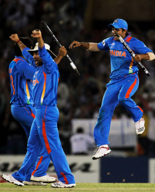 Sachin Tendulkar, Suresh Raina and Munaf Patel celebrate after India ended up winners, India v Pakistan, 2nd semi-final, World Cup 2011, Mohali, March 30, 2011