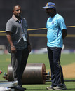 Muttiah Muralitharan chats with Aravinda de Silva during Sri Lanka's nets, Mumbai, March 31, 2011