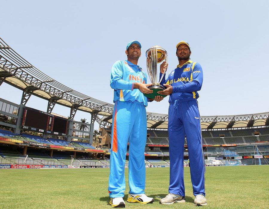 MS Dhoni and Kumar Sangakkara hold aloft the World Cup at the Wankhede Stadium
