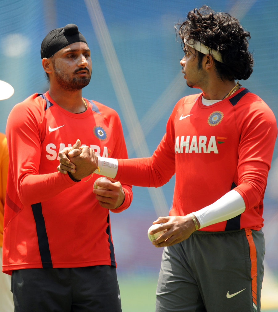 Harbhajan Singh and Sreesanth share a thought during bowling practice