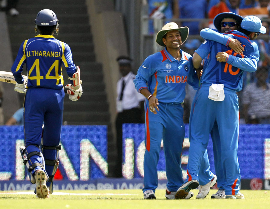 Team-mates congratulate Virender Sehwag after he took a catch to dismiss Upul Tharanga