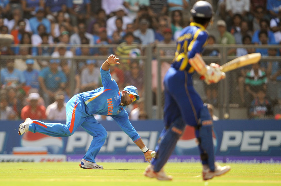 Yuvraj Singh reaches out to stop the ball