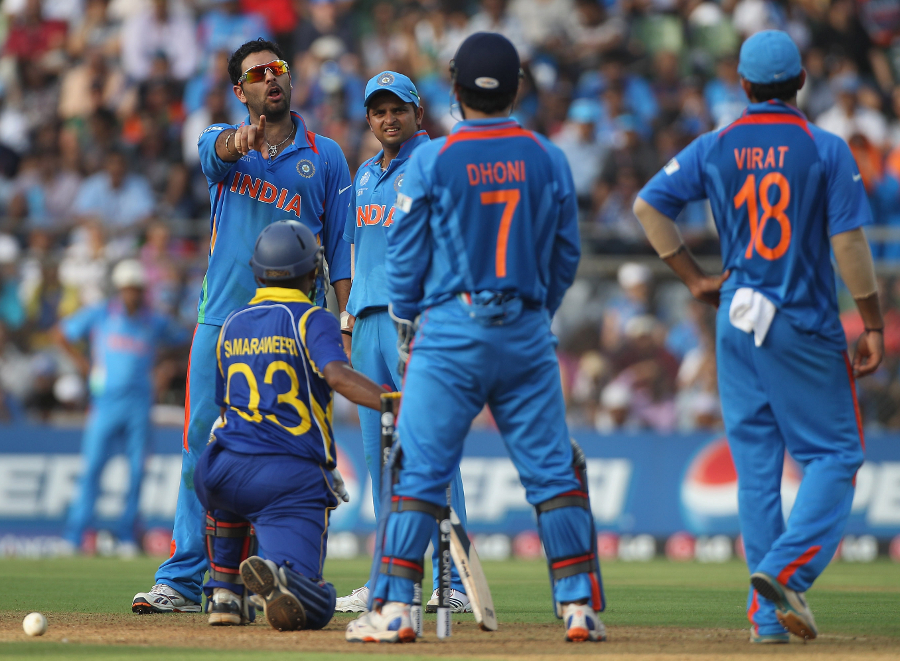 Yuvraj Singh implores MS Dhoni to call for a review after his appeal for Thilan Samaraweera's wicket was turned down
