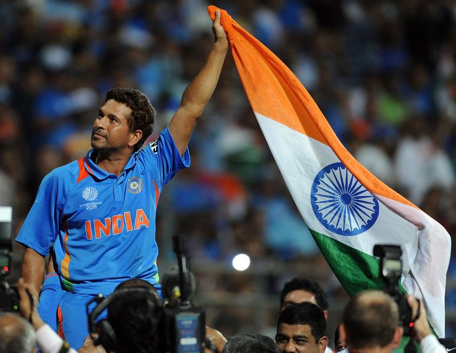 Sachin Tendulkar waves the India flag in triumph