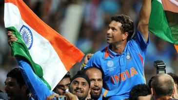 Sachin Tendulkar, World Cup winner, gets a victory lap around his home ground