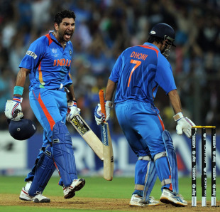 Yuvraj Singh roars as MS Dhoni uproots stumps after taking India to victory in the World Cup final, World Cup 2011, Mumbai, April 2, 2011