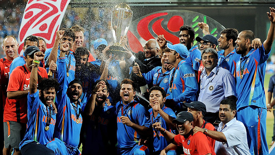 The Indian team celebrates with the Cup that counts
