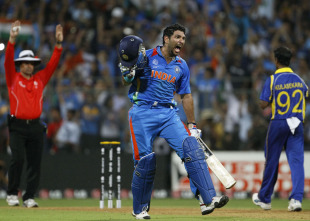 Yuvraj Singh roars as umpire Aleem Dar signals the winning six, India v Sri Lanka, final, World Cup 2011, Mumbai, April 2, 2011