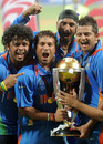 Sreesanth, Sachin Tendulkar, Harbhajan Singh and Suresh Raina celebrate with the trophy, India v Sri Lanka, final, World Cup 2011, Mumbai, April 2, 2011