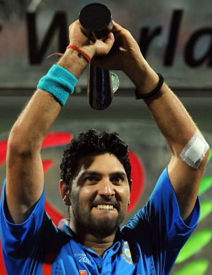 A proud Yuvraj Singh holds the Player of the Tournament trophy, India v Sri Lanka, final, World Cup 2011, Mumbai, April 2, 2011