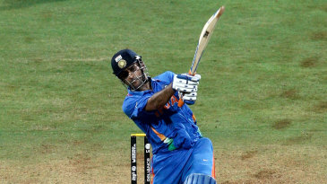 Disappointment and contentment. MS Dhoni and Kumar Sangakkara see the winning hit sail out of the ground