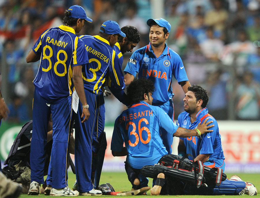 Tears of elation for Yuvraj Singh as he is surrounded by players from both teams