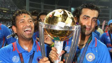 Sachin Tendulkar and Gautam Gambhir walk with the trophy