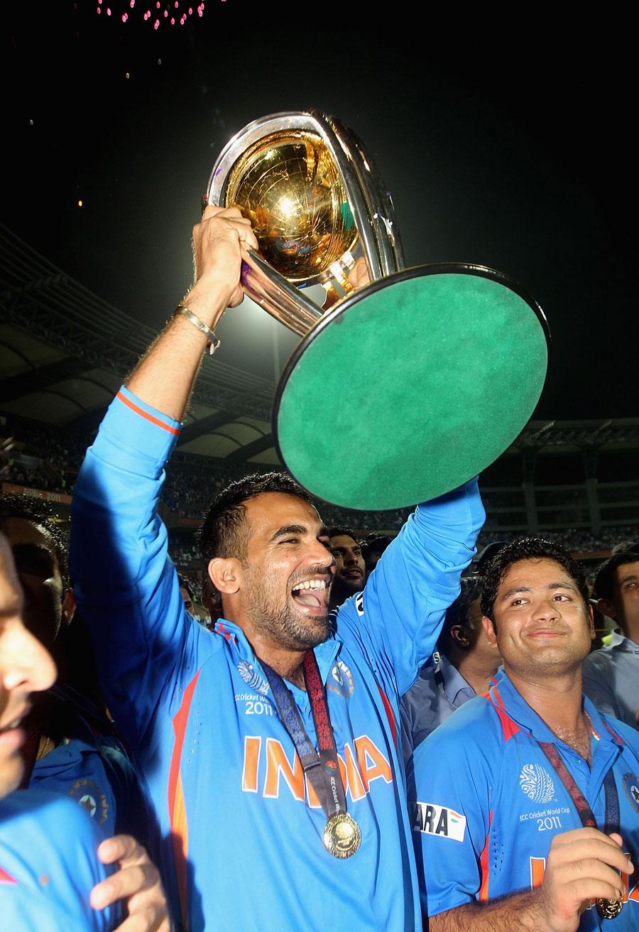 Zaheer Khan holds aloft the World Cup