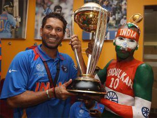 Sachin Tendulkar holds aloft the World Cup with one of his long-time fans, Sudhir Gautam, April 2, 2011