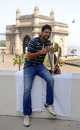 Yuvraj Singh with the World Cup trophy in front of the Gateway of India