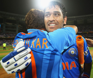 An emotional MS Dhoni is hugged by Sachin Tendulkar after India's victory, India v Sri Lanka, final, World Cup 2011, Mumbai, April 2, 2011
