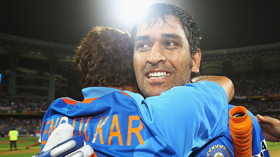 An emotional MS Dhoni is hugged by Sachin Tendulkar after India's victory