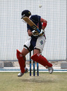 Courtney Kruger evades a short ball during Hong Kong's training session at the ICC Global Cricket Academy in Dubai