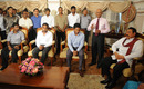 The Sri Lankan team sit with their country's president Mahinda Rajapakse