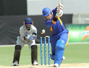 Sarel Burger of Namibia is bowled cheaply in a ICC World Cricket League Division Two match
