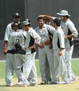Team-mates congratulate Shadeep Silva after he knocked over Sarel Burger, UAE v Namibia, Dubai, April 8, 2011