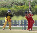 Courtney Krugers drives the ball against Uganda during the ICC World Cricket League Division 2 in Dubai