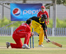 Uganda's Charles Waiswa is run out to hand Hong Kong a thrilling 26-run victory at the ICC World Cricket League Division 2 in Dubai on 8th April 2011