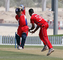 Bermuda's Jason Anderson is given an early life as Irfan Ahmed cannot not hold on to a return catch in the ICC WCL Division 2 match in Dubai on 9th April 2011